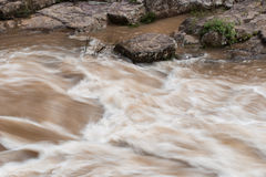 Strong river with rock Royalty Free Stock Photo