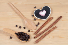 Strong roasted coffee beans on grunge  wood Stock Photos