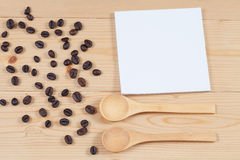 Strong roasted coffee beans on grunge  wood Stock Photography