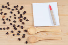 Strong roasted coffee beans on grunge  wood Stock Images