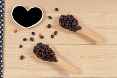 Strong roasted coffee beans on grunge  wood Stock Image