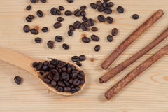 Strong roasted coffee beans on grunge  wood Royalty Free Stock Photos