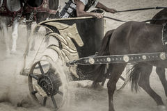 Strong, Roman chariot in a fight of gladiators, bloody circus Stock Photography