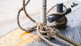 Rope knot safety boat river wave background Royalty Free Stock Images