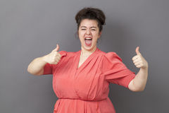 Strong 20s xxl woman expressing fun victory Royalty Free Stock Images