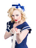 Strong sailor pin-up model pulling on tough rope Stock Photo