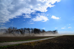 Strong sand storm on a field. With blue sky Stock Photos