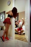 Strong Santa Claus at home Stock Image