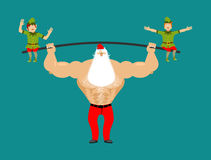 Strong Santa lift barbell with elves. powerlifting elf gravity. Royalty Free Stock Photography