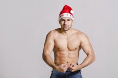 Strong Santa posing with bodybuilding pose royalty free stock image