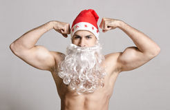 Strong Santa posing in studio shot Royalty Free Stock Image