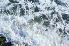 Strong sea wave splashing on the beach shore Stock Photos