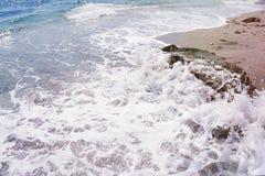 Strong sea wave splashing on the beach shore Stock Photo