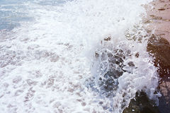Strong sea wave splashing on the beach shore Stock Photography