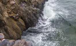 Strong sea waves crush the cliff at Koh Sichang,Chonburi,Thailand. Royalty Free Stock Photos