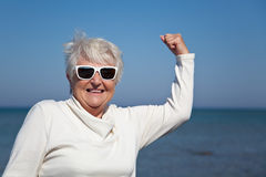 Strong Senior. A senior woman takes pride and glee in being strong and healthy royalty free stock photo