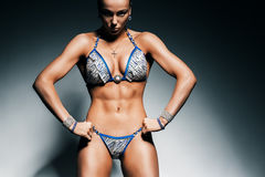 Strong serious sporty woman in blue bikini Stock Photo