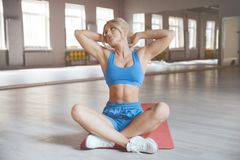 Strong athletic young woman working out in gym. Beautiful strong athletic muscular young caucasian fitness woman workout training in the gym on diet pumping up stock photos