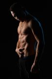 Strong sexy man on  black background Stock Images