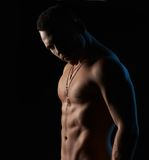 Strong sexy man on  black background Royalty Free Stock Photos