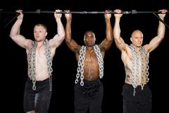 Strong men perform pullups