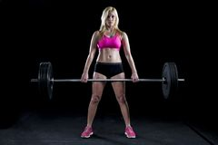 Strong woman deadlifts a lot of weight Stock Image