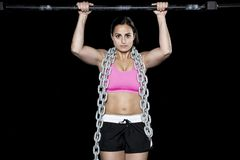 Strong woman does a pull up Stock Image