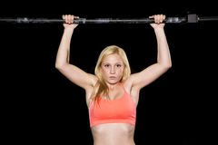 Strong sexy woman does a pull up Stock Photo