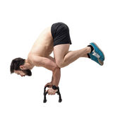Strong shirtless athlete handstands balancing on push up bars Stock Photography