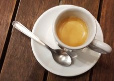 Strong short coffee on wooden table. Short and strong espresso coffee in white cup on wooden table stock image