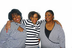 Strong Sisterhood. A picture of three happy sisters hugging one another Royalty Free Stock Photos