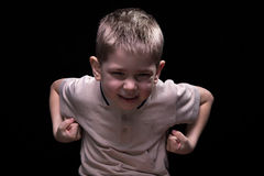 Strong smiling little boy Stock Photos