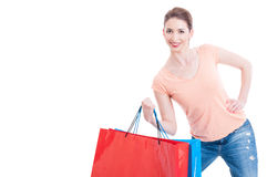 Strong smiling shopping woman holding gift bags Stock Photos