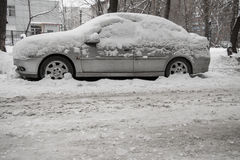 After a strong snow storm car covered in snow Royalty Free Stock Image