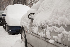 After a strong snow storm car covered in snow Stock Photo