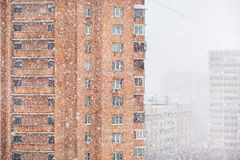 Strong snowing and apartment houses in city Royalty Free Stock Photography