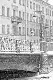 The strong snowstorm in Saint Petersburg. Demidov bridge. Royalty Free Stock Images