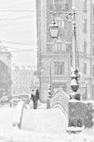 The strong snowstorm in Saint Petersburg. People walking along Demidov bridge. Royalty Free Stock Image