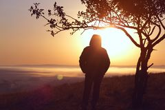 Strong girl standing facing the sun Royalty Free Stock Images