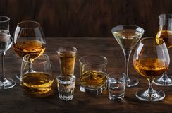 Strong Spirits Set. Hard alcoholic drinks in glasses in assortment: vodka, cognac, tequila, brandy and whiskey, grappa, liqueur,. Vermouth, tincture, rum royalty free stock photos