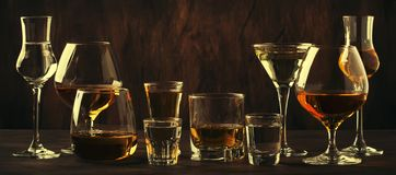 Strong Spirits Set. Hard alcoholic drinks in glasses in assortment: vodka, cognac, tequila, brandy and whiskey, grappa, liqueur,. Vermouth, tincture, rum stock photos