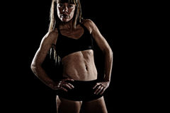 Strong sport freckles woman posing defiant in cool attitude with welt built body Royalty Free Stock Image