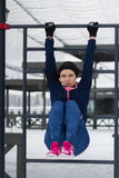 Strong sport woman doing strength exercises on work out fitness at snow winter park Stock Photo