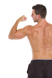 Strong sports man showing biceps. Rear view Stock Images