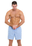Strong sports man showing muscles Royalty Free Stock Photos