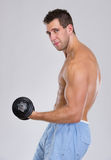 Strong sports man workout biceps with dumbbell Royalty Free Stock Images