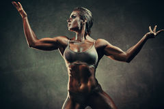 Strong sports woman. On wall background. Vintage film style colors effect royalty free stock photo