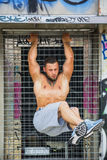 Strong sportsman doing abs exercise outdoor Royalty Free Stock Images