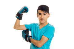Strong sportsman practicing boxing in blue gloves isolated on white background Stock Photography