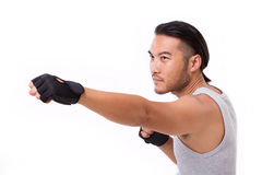 Strong sportsman punching Stock Images